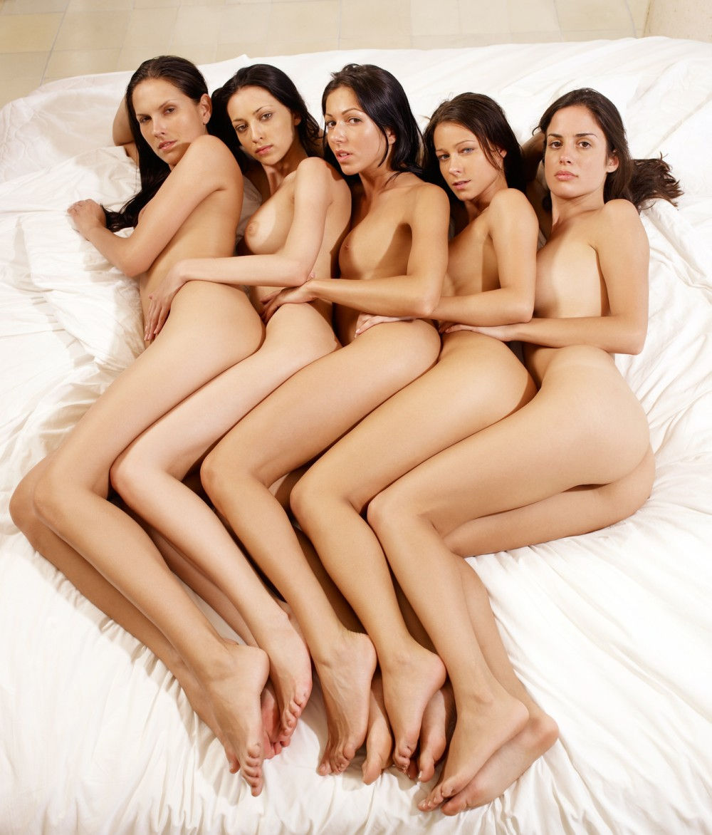 group of girls naked on a bed